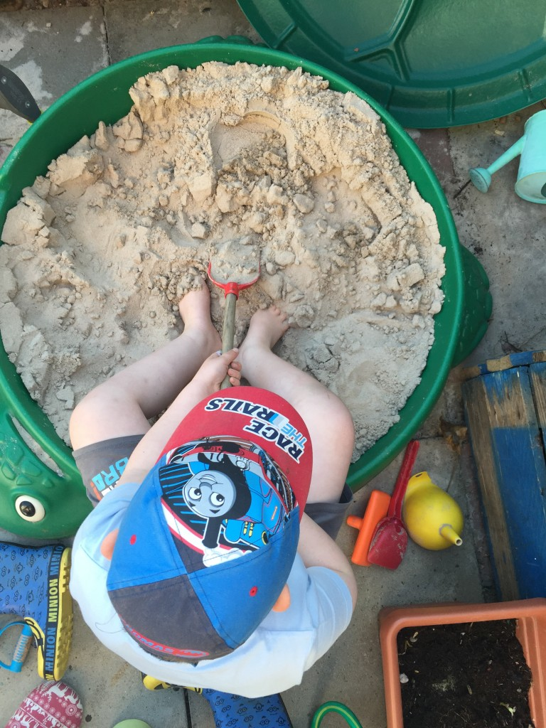 playing in the sand pit