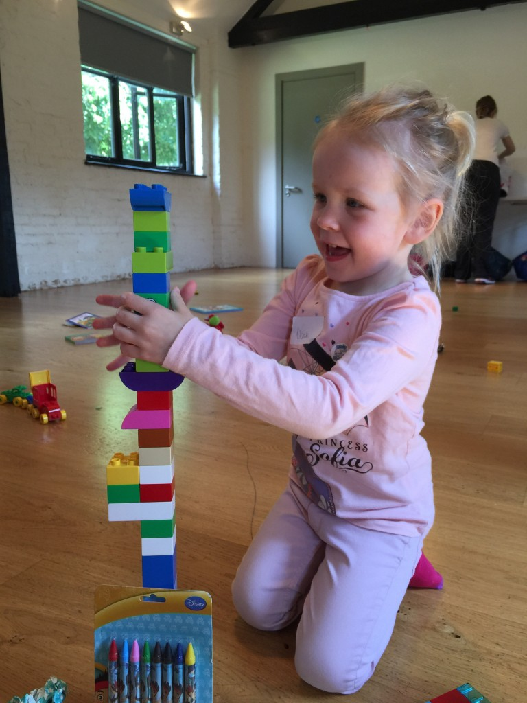 playing with Lego bricks