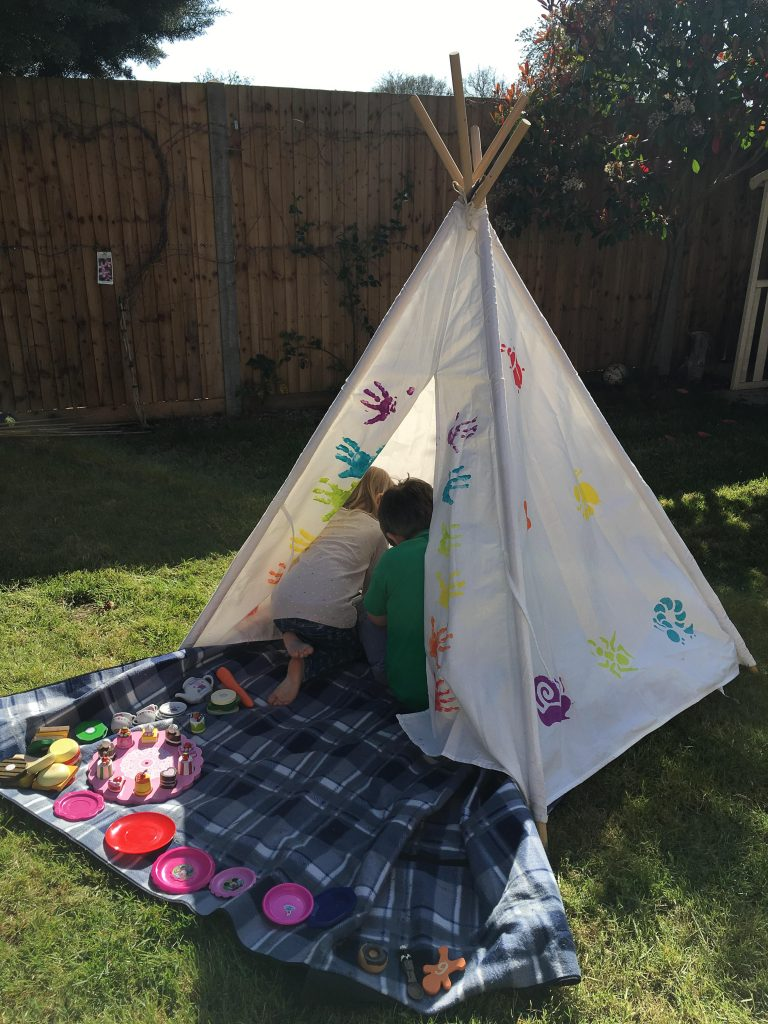 playing in a teepee